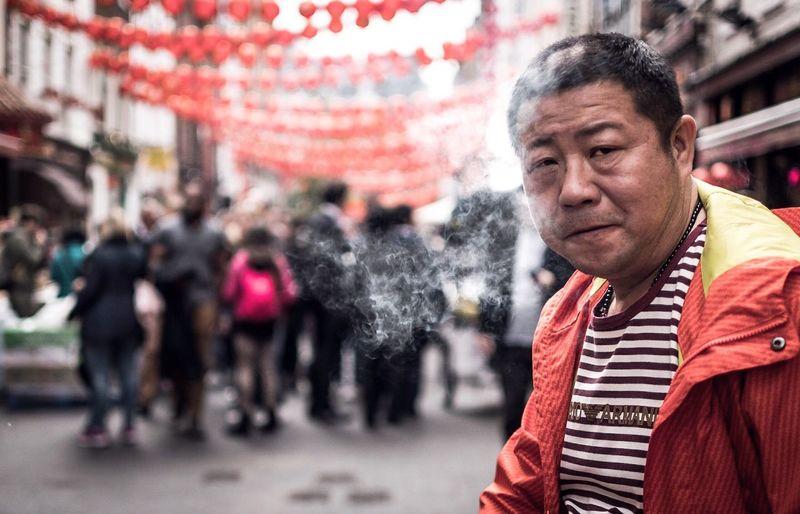 Portrait of man on street in city