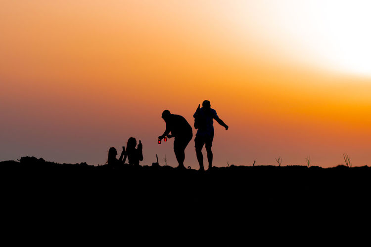Malta Activity Beauty In Nature Bonding Copy Space Friendship Group Of People Land Leisure Activity Lifestyles Maltaphotography Men Nature Orange Color People Real People Scenics - Nature Silhouette Sky Standing Sunset Togetherness
