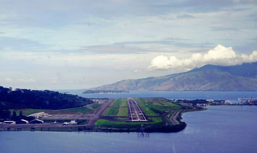 On finals, cleared to land.. Philippines Subic Bay International Airport Onfinals Runway Sea Blue Sky Green Nature No People Water Mountain Runway Lights Cockpit View Cockpit Landing Pilotseye Pilotsview Sky Blue Ocean View Island View  Airport Photography Aviationphotography Adventure Aviationismylife BornToFly