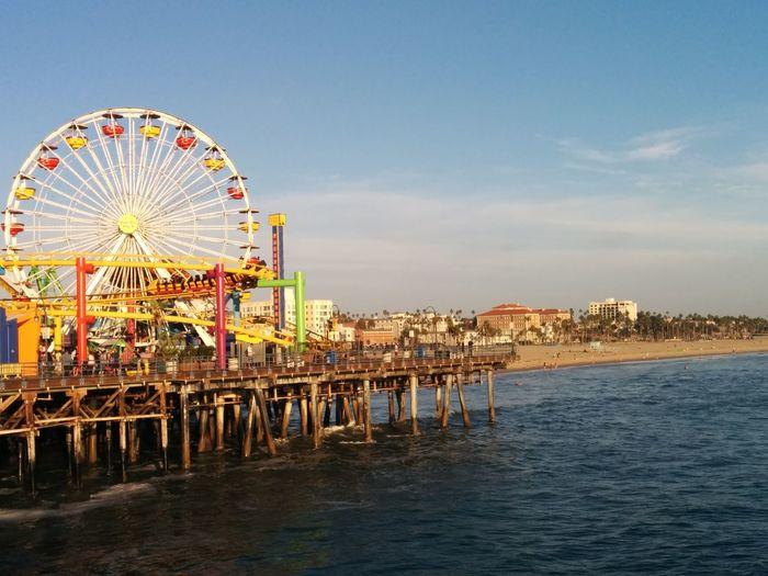 Carousel Ferris Wheel Sea Amusement Park Ride Beach Illuminated Arts Culture And Entertainment Summer Amusement Park Fun Horizon Over Water Shore Ocean Pier Wave Tide Sunset