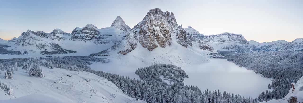 Mount Assiniboine national park. This picture is available in 800 mega pixel (49000 x 16500) resolution for wall size corporate printing. This place is almost in accessible this time of the year. You have to fly to the hut area via helicopter. Then from the hut it takes us about 2 days to break trail through knee deep snows to get up to this location Assiniboine Park Mount Assiniboine Alberta Canada Alberta British Columbia Cold Temperature Snow Winter Beauty In Nature Tranquil Scene Mountain Sky No People Idyllic Landscape Frozen Mountain Peak Scenics - Nature Mountain Range Tree Tranquility Extreme Weather Environment Nature Snowcapped Mountain