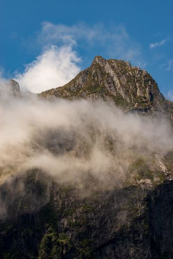 Cloud by mountain against sky