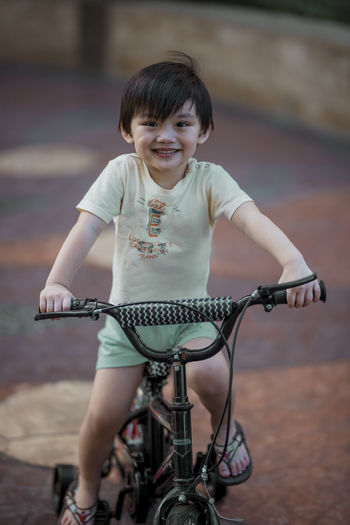 Play time!!! Eyeem Philippines The Week on EyeEm Bicycle Casual Clothing Child Childhood Cute Females Focus On Foreground Front View Full Length Innocence Land Vehicle Leisure Activity Lifestyles Looking At Camera Mode Of Transportation One Person Outdoors Portrait Real People Riding Transportation
