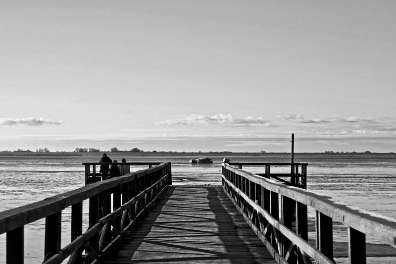 Beach Beauty In Nature Built Structure Day Direction Horizon Horizon Over Water Incidental People Land Nature Outdoors Pier Railing Scenics - Nature Sea Sky Tranquil Scene Tranquility Water Wood - Material