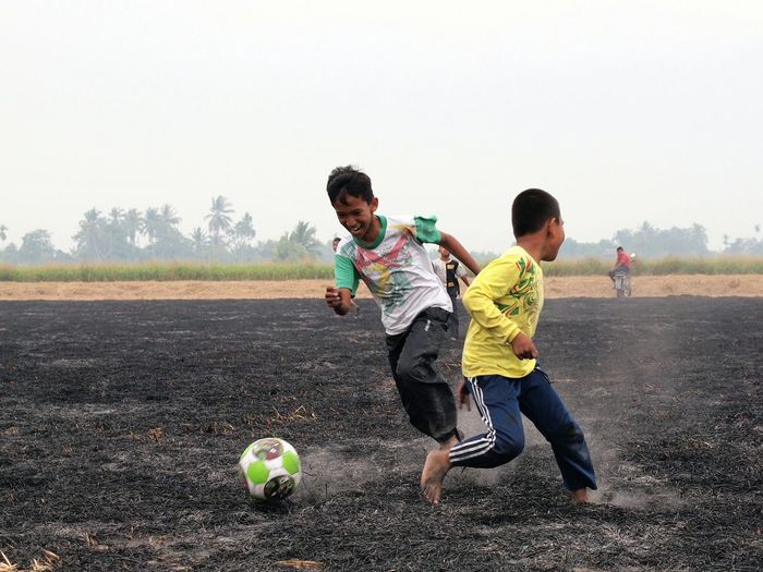 Street soccer Kids Playing At The Paddy Field Kids Are Awesome Bola Kampung Olympic Kids Playing Football With Bare Foot Enjoying Life Colour Of Life Colors Of Malaysia Moments Of Life Unforgettable Moment Hometown Scenery Kids Moment Asian Kids Kids And Football Fun In Field