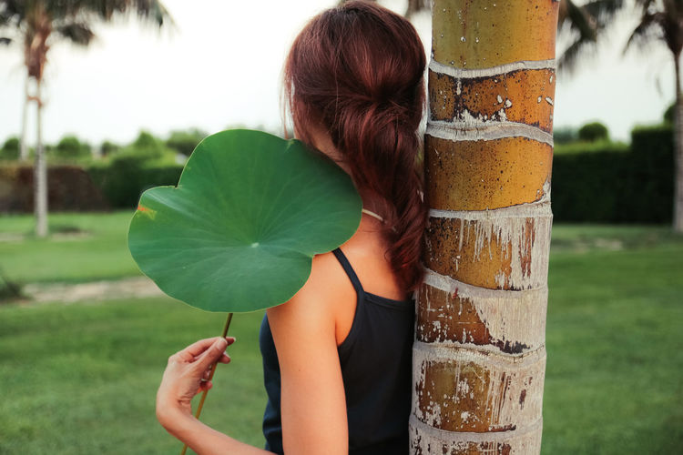 Leaf me here Back View Grass Portrait Of A Woman Sicily Summertime Beauty In Nature Close-up Garden Green Color Holding Leaf Lifestyles Nature One Person Outdoors Portraiture Real People Red Hair Tree Tree Trunk Woman Portrait Inner Power International Women's Day 2019