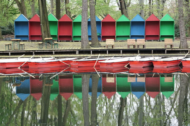 Colorful huts reflecting on calm lake