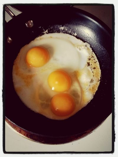 Two eggs yield three yolks = a breakfast surprise. Breakfast