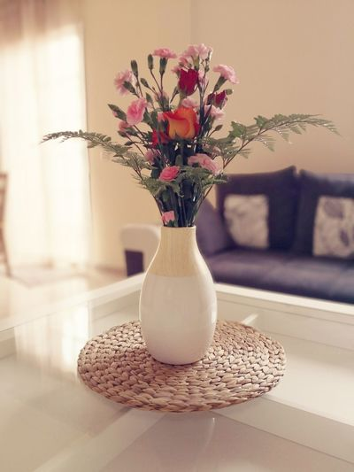 Close-up of flowers in vase on table at home