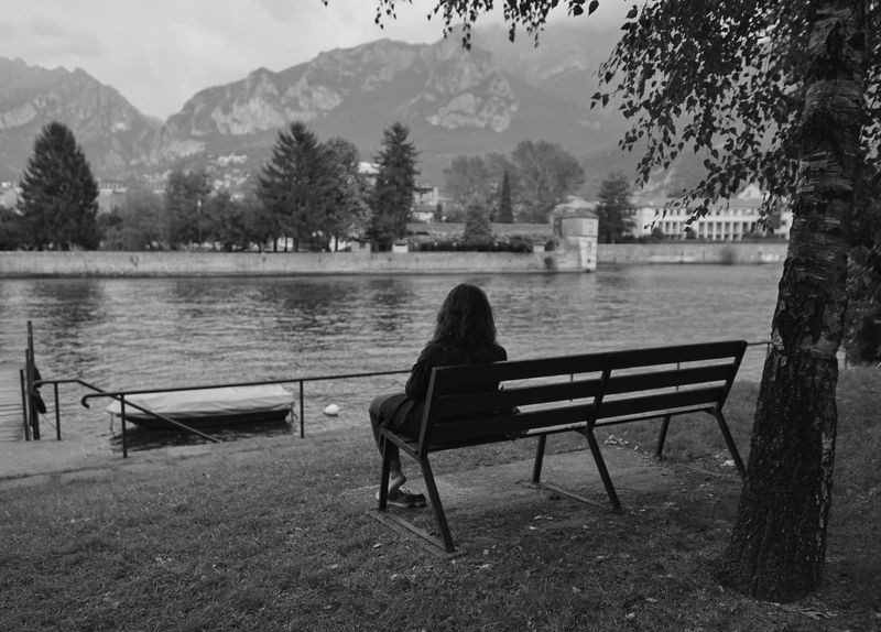 Rear View Sitting Only Women Water Women Adult Tree Lake One Woman Only Outdoors One Young Woman Only People Lago Di Como, Italy Sony A7RII Sony A7rm2 EyeEm Selects Sal24f20z Zeiss Blackandwhitephoto Black & White Photography Black And White