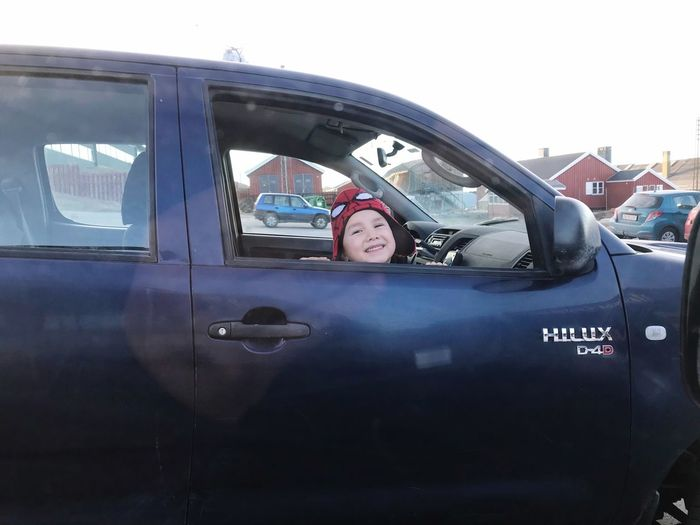 some cute kid, trying to get attention. Kids Kid Cute Smile Portrait One Person Car Motor Vehicle Window Outdoors Smiling