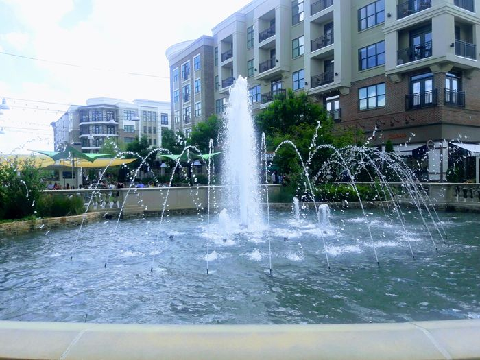 Water Building Exterior Architecture Built Structure City Fountain Spraying Wet Outdoors Day Modern Water Park Skyscraper Adapted To The City Flower Head I LOVE PHOTOGRAPHY Enjoying Life Plant Photography Is My Life Atlanta Photographer Freshness Growth No People Sky Water Slide