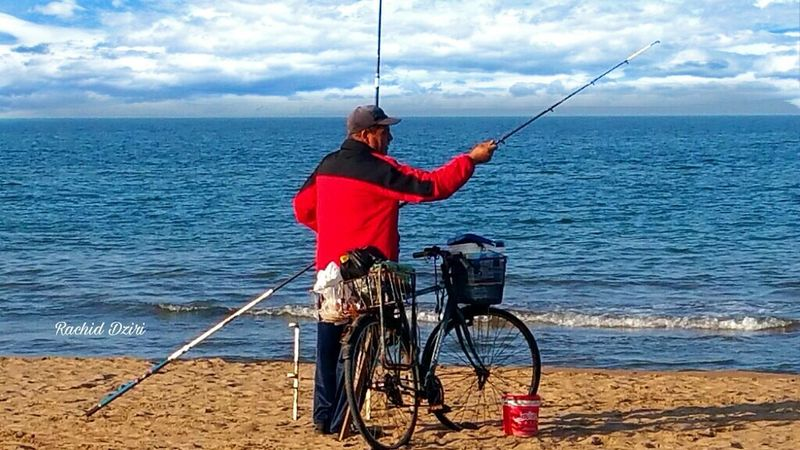 Beach Photography Sea Water Cloud - Sky Beauty In Nature Adult One Person Horizon Over Water People Sky Day Only Men Fishing Tackle Fishermanvillage Fisher Man Beauty Tourism Travel Quietude Tranquility Morocco Beauty Morocco 🇲🇦 Beach Holiday