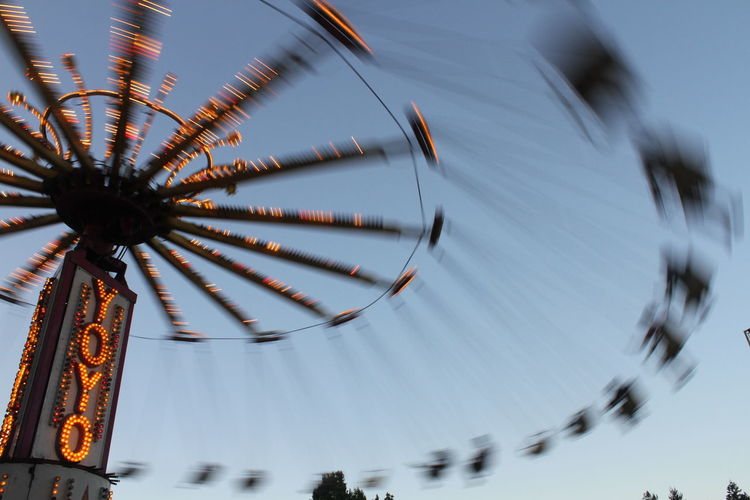 Blurred motion of chain swing ride at amusement park