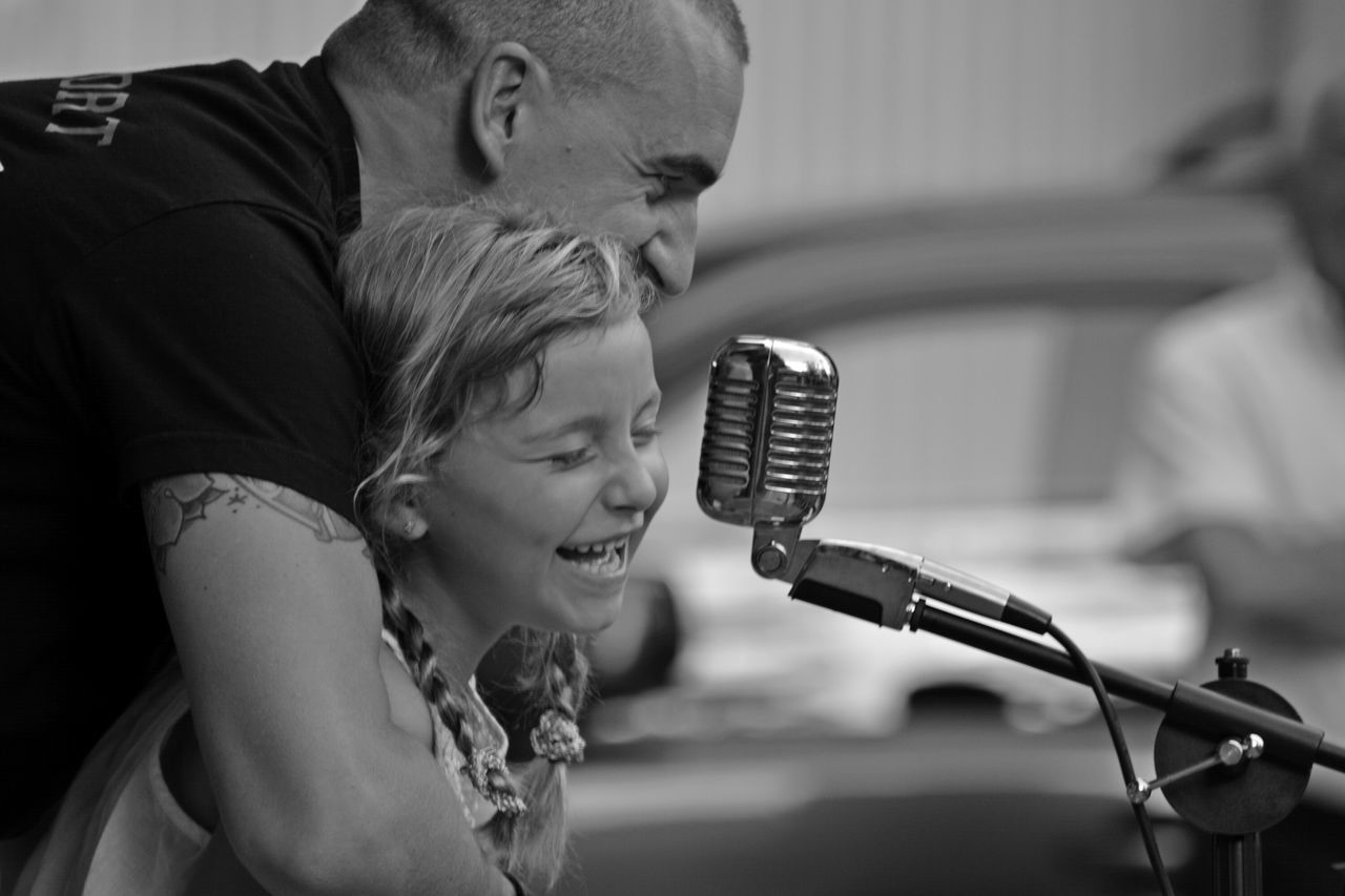 two people, microphone, real people, focus on foreground, indoors, side view, togetherness, men, young adult, musician, young women, close-up, day, people