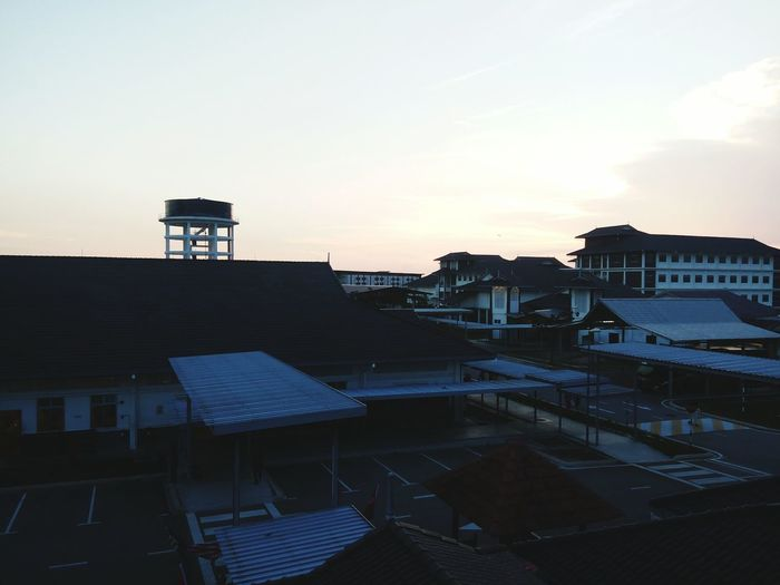 The Color Of School Building Exterior Built Structure Architecture Sunset Roof House Residential Structure Residential Building Sky High Angle View City Dusk Orange Color Cloud Rooftop Outdoors No People Town Residential District Exterior