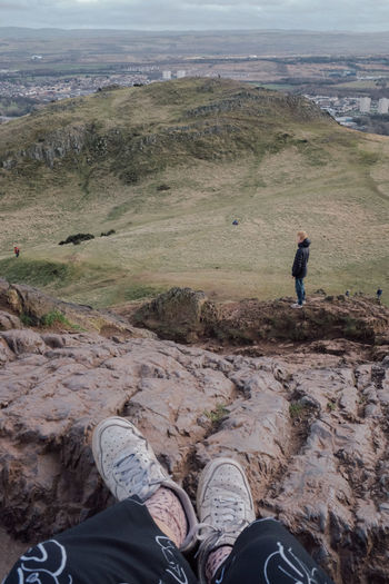 Arthur's Seat Leisure Activity Men One Person Environment Day Landscape Lifestyles Nature Real People Mountain Low Section Scenics - Nature Full Length Land Adult Adventure Human Body Part Personal Perspective Human Leg Body Part Outdoors