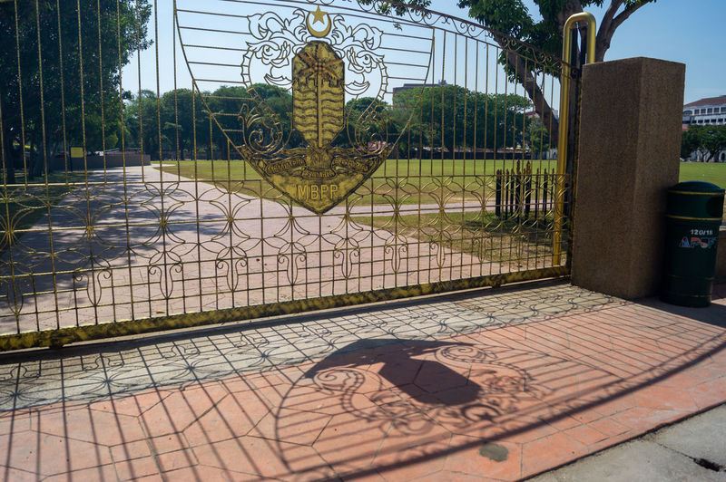 View of metal fence in park