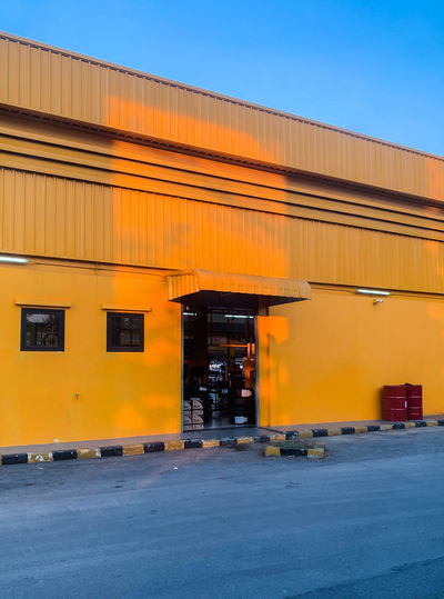 Garage Built Structure Sky Transportation Building Exterior City Yellow Sunlight Shade Lighting Garage Colorful Iphonephotography IPhoneography IPhoneXR Blue Contrast Color Light Light And Shadow Minimal Minimalism Architecture Minimalist Architecture The Mobile Photographer - 2019 EyeEm Awards The Architect - 2019 EyeEm Awards