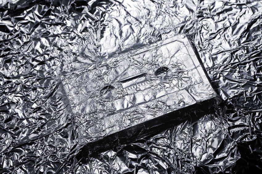 Audio compact cassette covered with aluminium foil. 1980s Audio Cassette Compact Cassette Concept Conceptual Covered Crinkled Crumpled Encased Foilage Metallic Music Nobody Object Shape Silver  Sound Tape Turkey Under Wrinkled Wrinkles Of The City