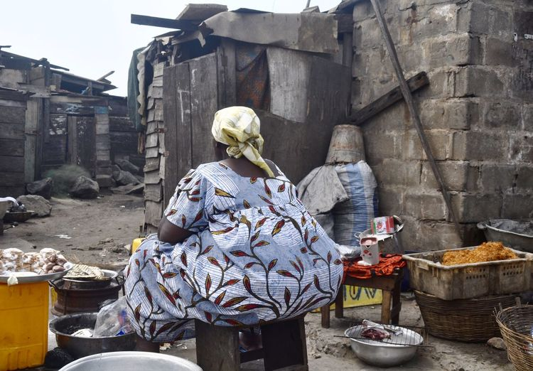 Rear view of woman cooking outdoors