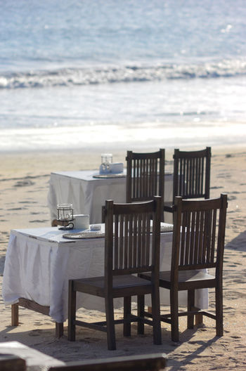 Tables And Chairs Arranged At Beach