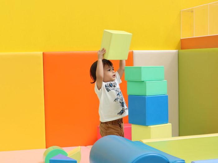 Cute boy stacking blocks