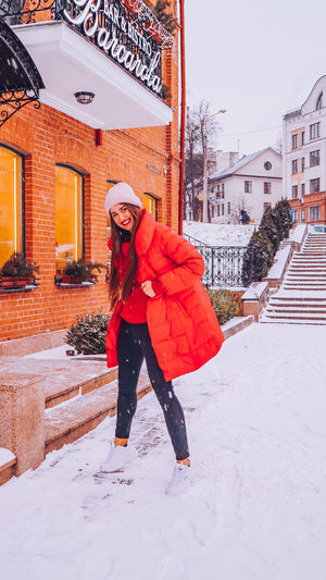 Beautiful happy smiling woman on the street in warm red winter coat on Christmas time on snowing. Winter Cold Temperature Warm Clothing Snowing Smiling Christmas Wintertime Woman Power women around the world EyeEm Best Shots EyeEm Colorful! Fashion Stories Red Lipstick Extreme Weather Nature Walking Standing Scarf Snow Architecture One Person Clothing Real People Building Exterior Full Length Built Structure Lifestyles Leisure Activity Women Front View