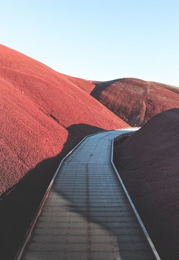 Exploring the Painted Hills Red Clear Sky Tranquil Scene Landscape Outdoors Nature No People Day Scenics Beauty In Nature Sand Dune