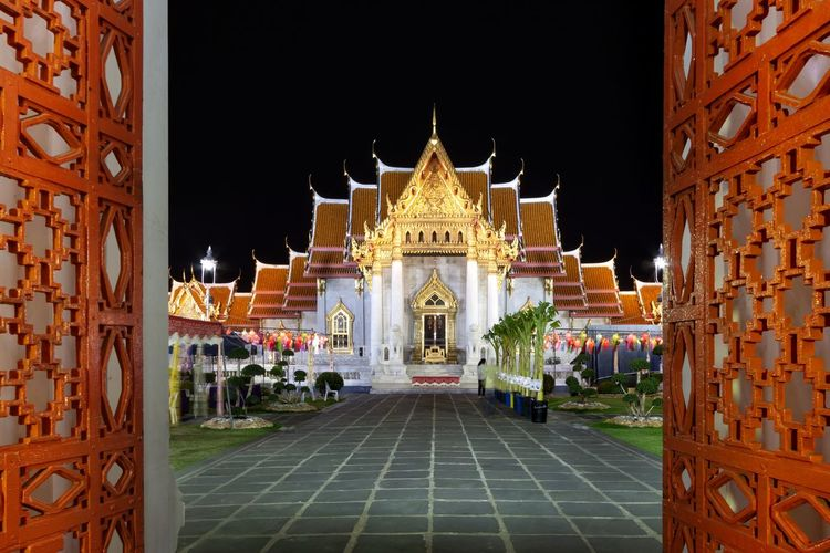 View of red gates of benchamabophit temple in bangkok
