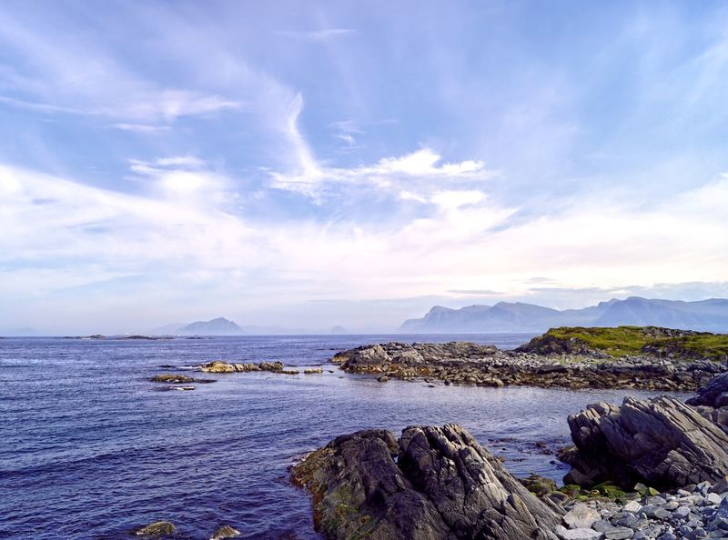 Misty clouds obscure the islands of Ållesund as seen from the island of Runde Misty Landscape Allesund Runde Norwegian Landscape Sky Water Cloud - Sky Beauty In Nature Scenics - Nature Tranquility Tranquil Scene Mountain Sea Nature Land Beach Rock - Object