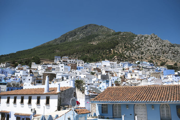 Architecture Blue Building Building Exterior Built Structure City Clear Sky Day House Morroco Mountain Nature No People Outdoors Residential District Roof Roof Tile Settlement Sky Sunlight Town TOWNSCAPE