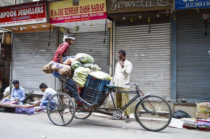 People sitting on bicycle in city