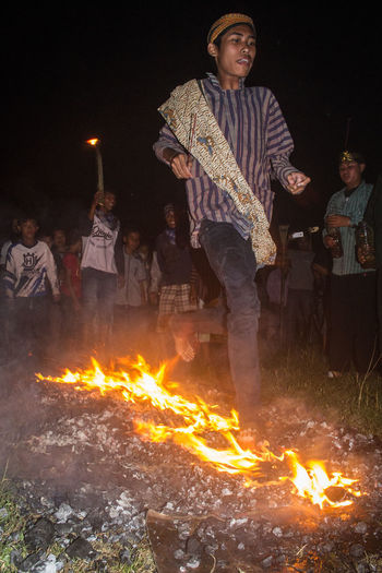man walk on fire INDONESIA Javanese Culture Javanese Tradition Bonfire Burning Campfire Casual Clothing Event Fire Fire Walk Flame Front View Heat - Temperature Men Nature Night Outdoors People Real People Standing Young Adult Inner Power EyeEmNewHere