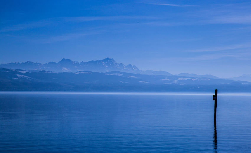 BlueMountains Scenics - Nature Water Tranquility Tranquil Scene Beauty In Nature Mountain Blue Sky Sea No People Idyllic Post Waterfront Outdoors Day Non-urban Scene Nature Bodensee Lakeofconstance Blue Sky Bluemountains Swissalps Swiss Germany Beautiful