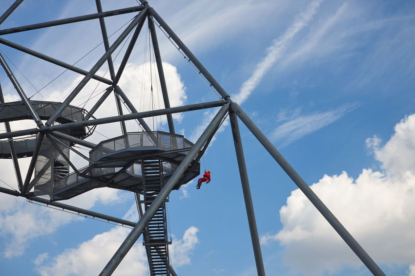 People rappel from top of the tetrahedron, steel tube structural sculpture which foam as pyramid or tetrahedron is located on the hill top of the mine dump Halde Beckstraße in Bottrop, Germany. #urbanana: The Urban Playground Bottrop Hanging Out Pyramid S Tetraeder Architecture Bridge Built Structure Cloud - Sky Connection Day Extream Germany Hill Low Angle View Metal Outdoors People Rappel Sculpture In The City Sky Steel Structure Tetrahedron