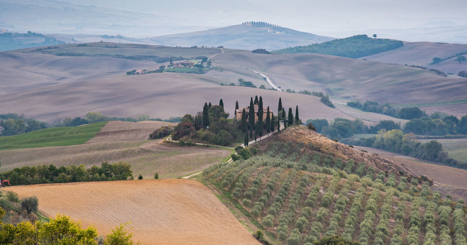 Beautiful idyllic farmland with meadow filed and farmhouse at tuscany area near pienza italy, europe