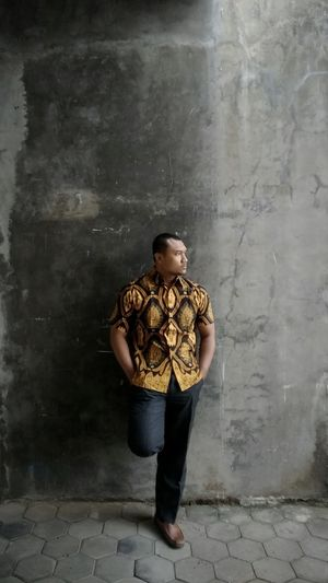 Stay humble with batik One Person Full Length Adult Architecture Young Adult Looking Wall - Building Feature Standing Men Front View Casual Clothing Males  Looking Away Indoors  Building Young Men Clothing Serious Contemplation Jeans Backgrounds Indonesian Street (Mobile) Photographie Indonesia_photography Background Photography Batik Indonesia