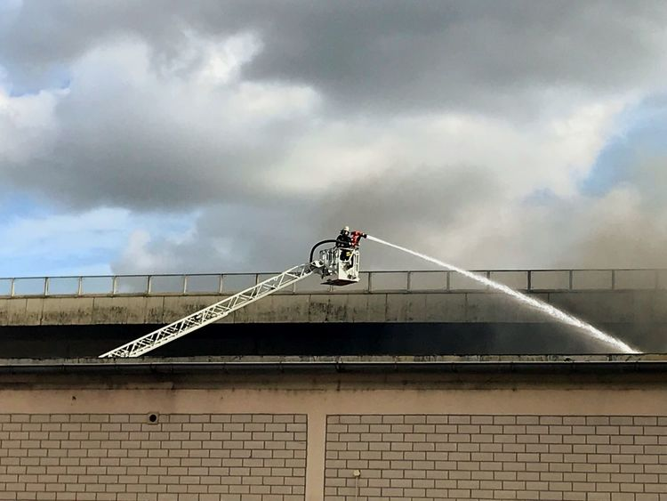 Cloud - Sky Built Structure Low Angle View Sky Architecture Day One Person RISK Outdoors Building Exterior Men Skill  Motion Real People Full Length Occupation One Man Only Only Men People Fire Firefighter FireFighting  Firefighters In Action Firefighter Equipment