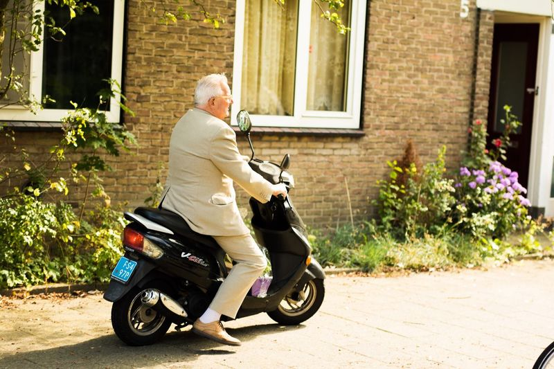 Motorcycle Full Length Senior Adult Sitting One Man Only Cool Grandpa Retirement One Person Lifestyles Outdoors Day Men Land Vehicle Only Men Adult One Senior Man Only Adults Only People