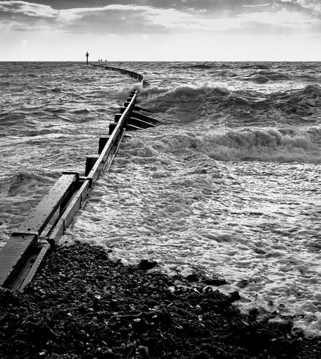 BREAKWATER: West Beach, Littlehampton, West Sussex, United Kingdom. The mouth of the River Arun is to the left, meeting the English Channel. Monochrome Shingle Energy Windy Choppy Beach Beauty In Nature Cloud - Sky Day Flowing Water Horizon Horizon Over Water Land Motion Nature No People Non-urban Scene Outdoors Scenics - Nature Sea Sky Tranquil Scene Water Wave Wooden Post