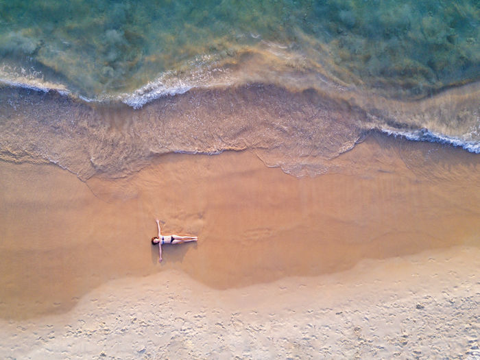 Drone shot on the beach Done That. Drone  Phuket,Thailand Wave Woman Aerial View Aerialshot Beauty In Nature Beauty In Nature Day Dronephotography Landscape Mavic Pro Nature One Person Outdoors Sand Scenics Tranquil Scene Tranquility Water Waterfront Young Adult Young Women