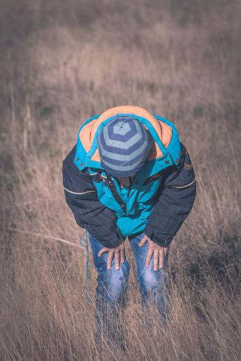 Boy on grassy field during winter