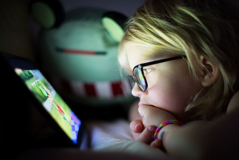 The attraction of a screen. Reality Modern Age Simplicity Lessismore Ipad Addiction Kids Habits Watching Ipad Watching A Movie Watching Ipad Documentary Exceptional Photographs Pentax FA 50mm/1.4 PENTAX K-1 Screen Screen Addiction Childhood Indoors  Real People Close-up Headshot Technology