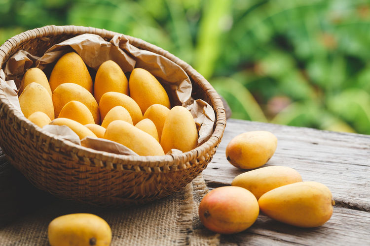 Fresh ripe mangoes ASIA Backgrounds Bamboo Basket Food Food Art Fresh Fruit Healthy Food Little Mango Mangoes Nature Nutrition Old Wood Plant Sweet Tasty Tropical Viet Nam Vitamin Yellow