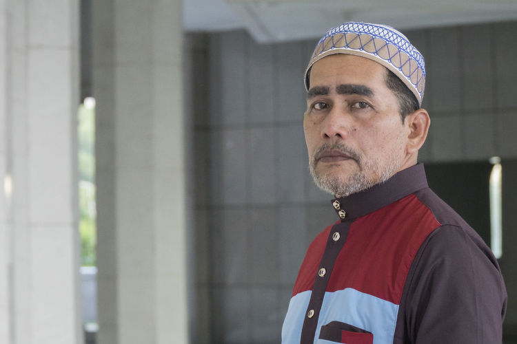 Portrait Of Mature Man Standing At Mosque