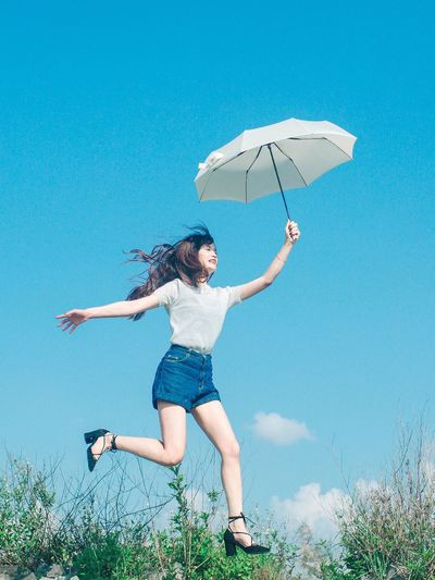 Girl Jump Umbrella Blue Sky