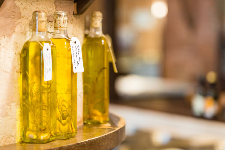 Olive Tree Artisanat Bookeh Bottle Bottles Close-up Focus On Foreground Gold Colored Indoors  Kitchen Kitchen Life No People Oli Olive Oil Rosemary Herb Spice Yellow
