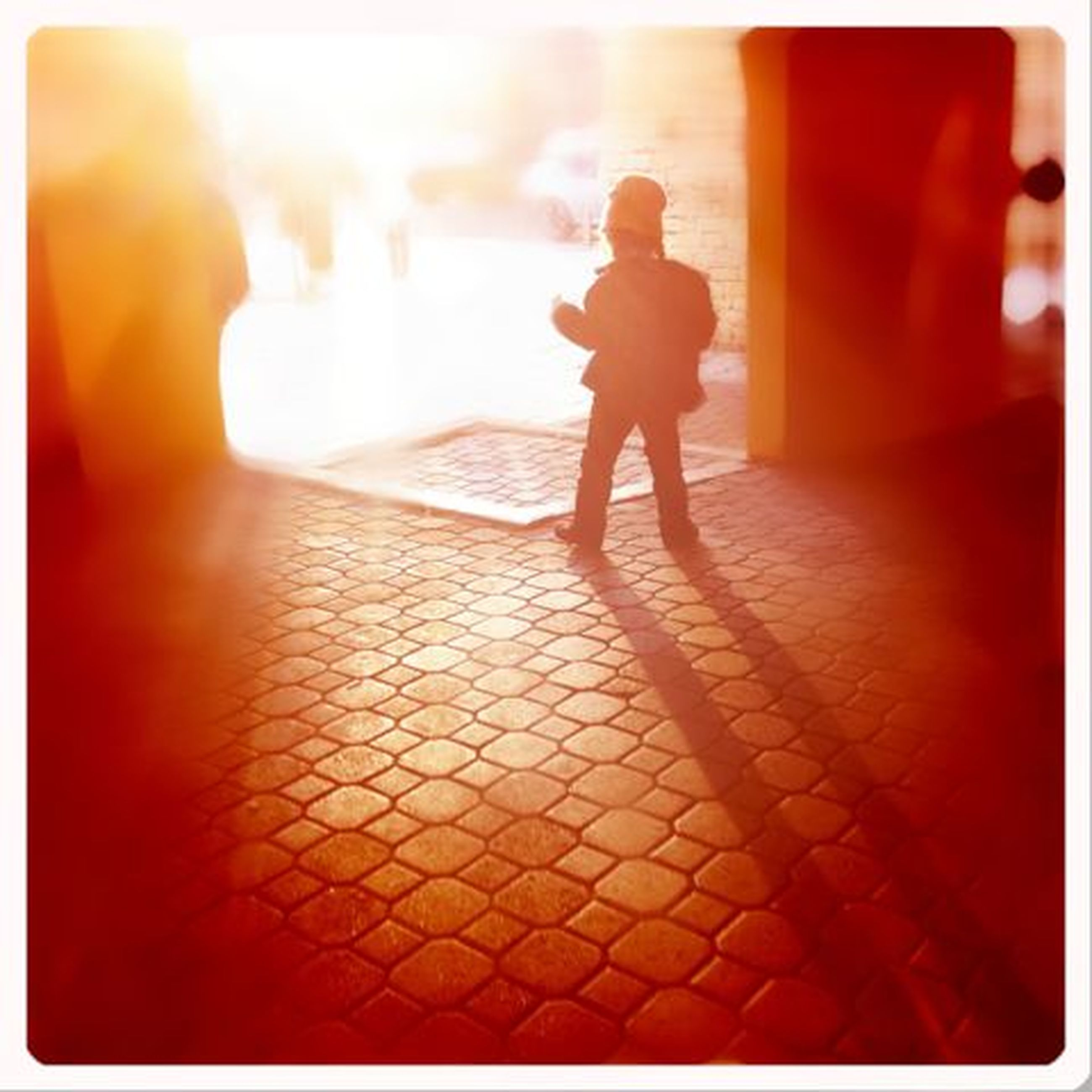 transfer print, auto post production filter, full length, lifestyles, walking, leisure activity, rear view, sunlight, men, standing, silhouette, person, shadow, childhood, street, sunset, casual clothing