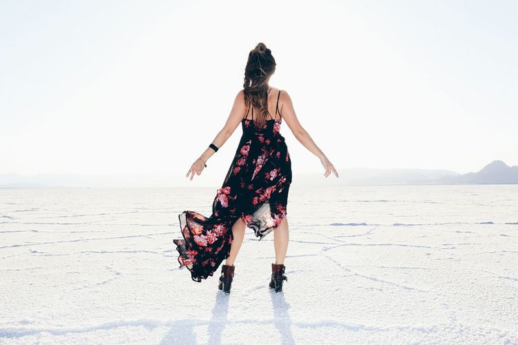 Rear view of woman standing at bonneville salt flats